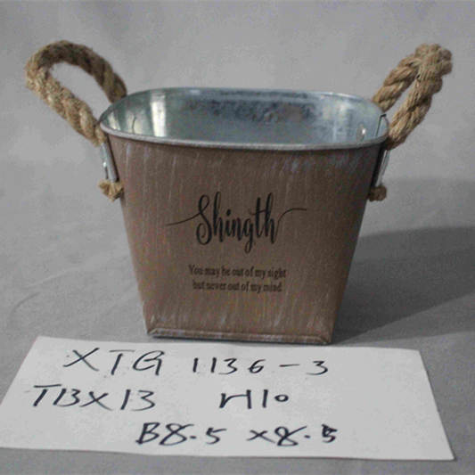 small brown square zinc pot with handle