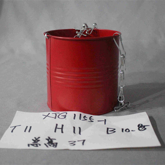 small red zinc bucket with chains