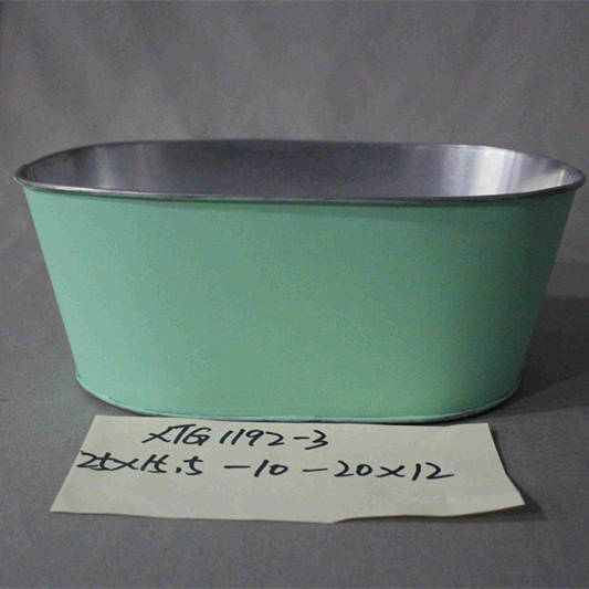 small green painted oval zinc pot