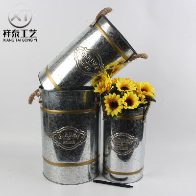 simple zinc flower bucket with two rope handles