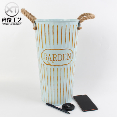 old zinc flower bucket with two rope handles