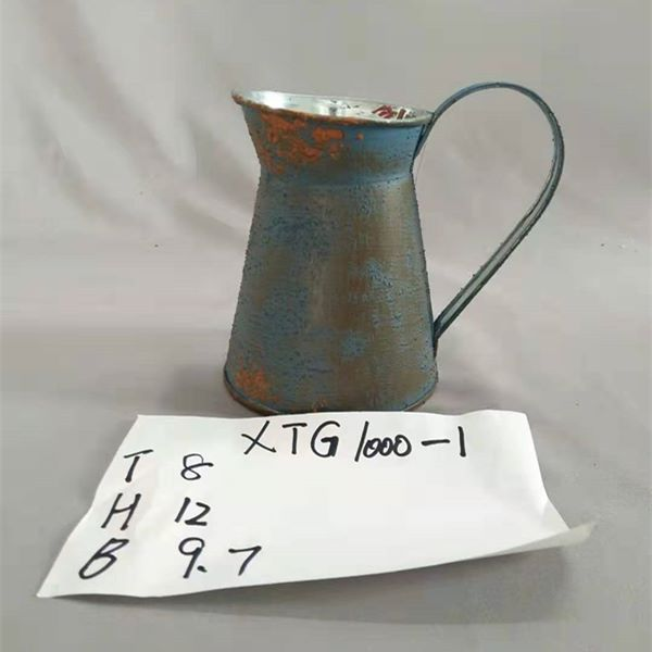 blue old zinc flower jug
